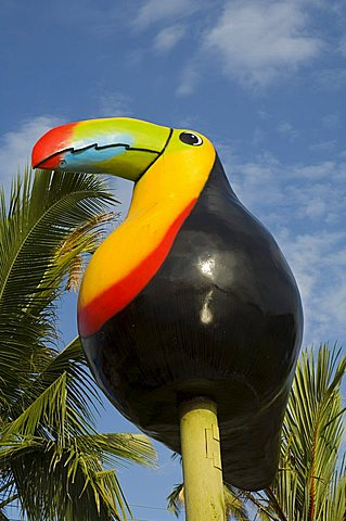 Giant statue of Toucan at the dock at the town of Tortuguero, Costa Rica, Central America