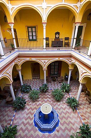 Typical riad style house now converted into Hotel Las Casas de la Juderia, Santa Cruz district, Seville, Andalusia, Spain, Europe