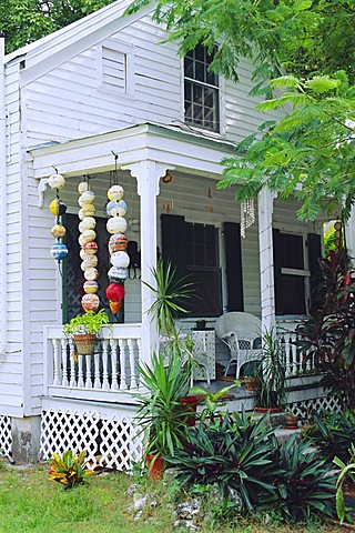 Fishing floats hanging in porch of old house in Key West, Florida, USA