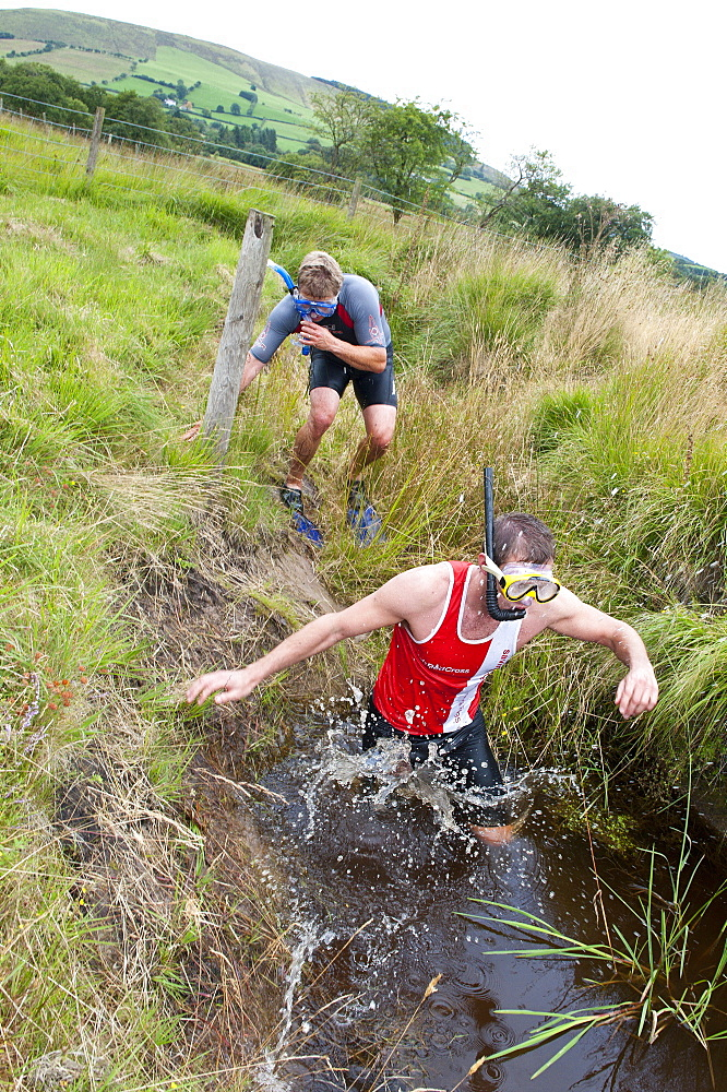 World Bogsnorkelling Championships, conceived in 1985 by Gordon Green, take place at Waen Rhydd Bog in the Cambrian Mountains, Powys, Wales, United Kingdom, Europe - 663-827