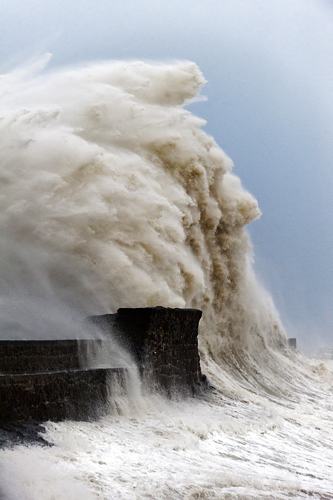 Huge waves crash against the harbour wall at Porthcawl, Bridgend, Wales, United Kingdom, Europe - 663-852