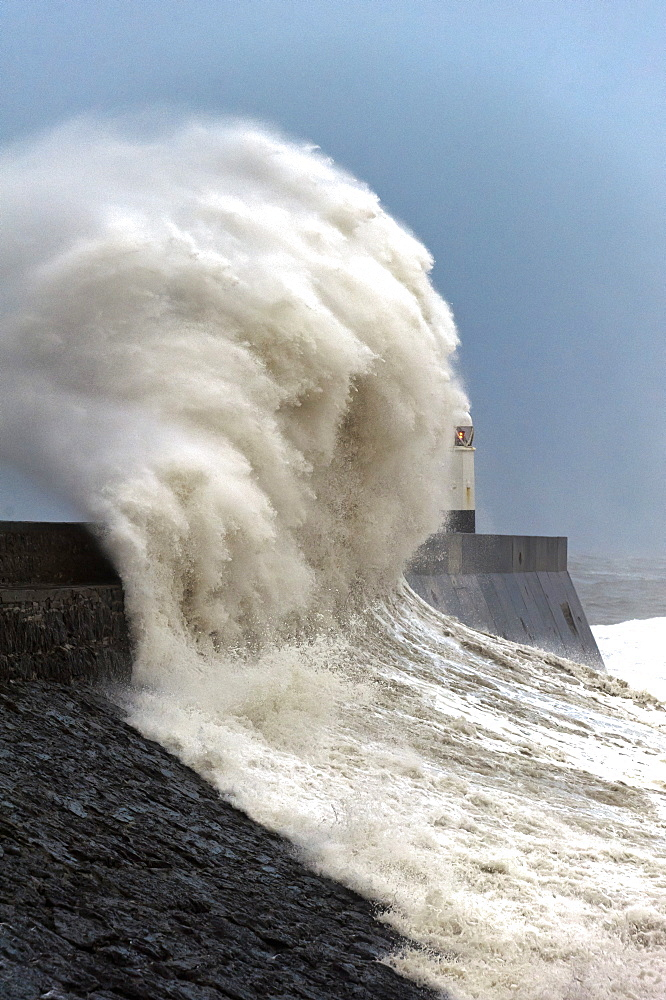 Huge waves crash against the harbour wall at Porthcawl, Bridgend, Wales, United Kingdom, Europe - 663-853