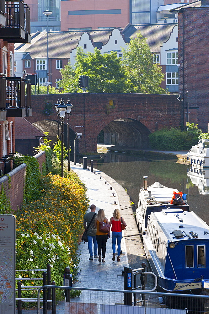 People walk along a tow path by the canal in Birmingham, West Midlands, England, United Kingdom, Europe - 663-896