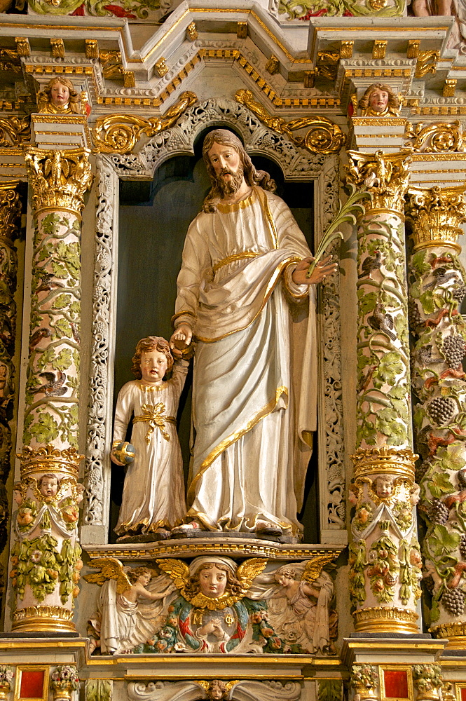Retable in the Rosary detail dating from the 17th century showing St. Joseph and child, Guimiliau parish church enclosure, Guimiliau, Finistere, Brittany, France, Europe