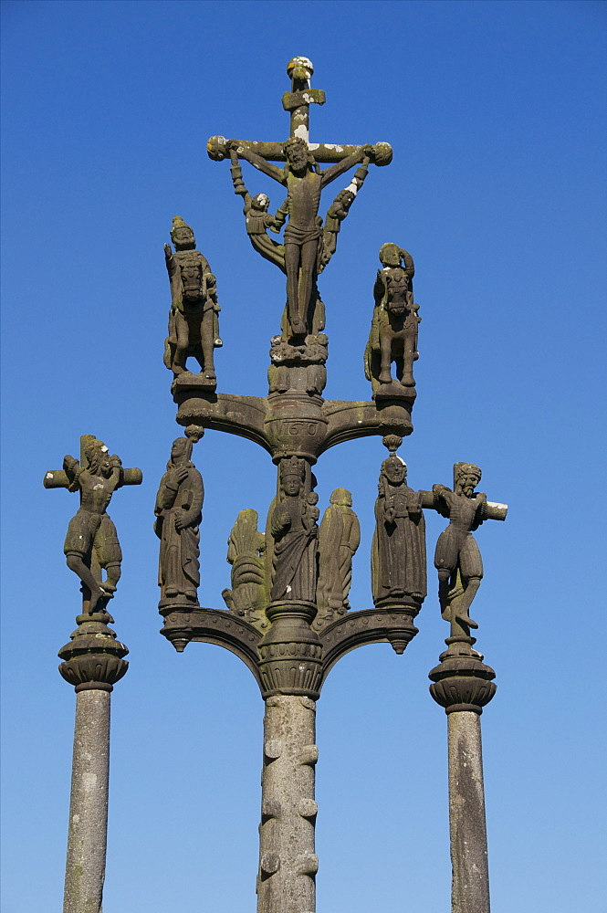 Calvary showing Christ on the cross flanked by two thieves, St. Thegonnec parish enclosure dating from 1610, Leon, Finistere, Brittany, France, Europe