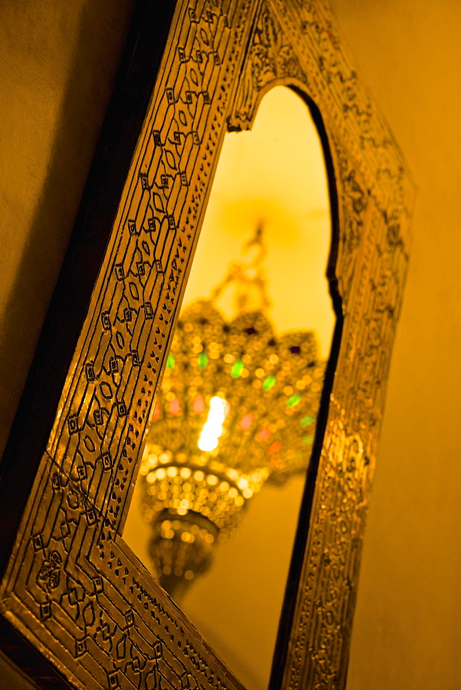 Brass ceiling lamp, reflected in typical mirror, Marrakech, Morocco, North Africa, Africa