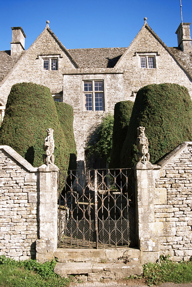 Cotswold house, topiary and gate, Ablington, Gloucestershire, The Cotswolds, England, United Kingdom, Europe