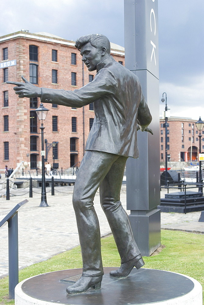 Statue by Tom Murphy of singer songwriter Billy Fury, near Albert Dock, Liverpool, Merseyside, England, United Kingdom, Europe