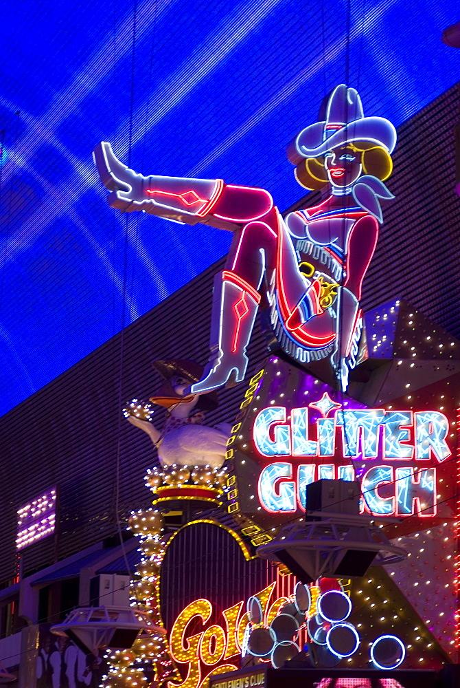 Illuminated girl on sign at Glitter Gulch, Fremont Street, Las Vegas, Nevada, United States of America, North America