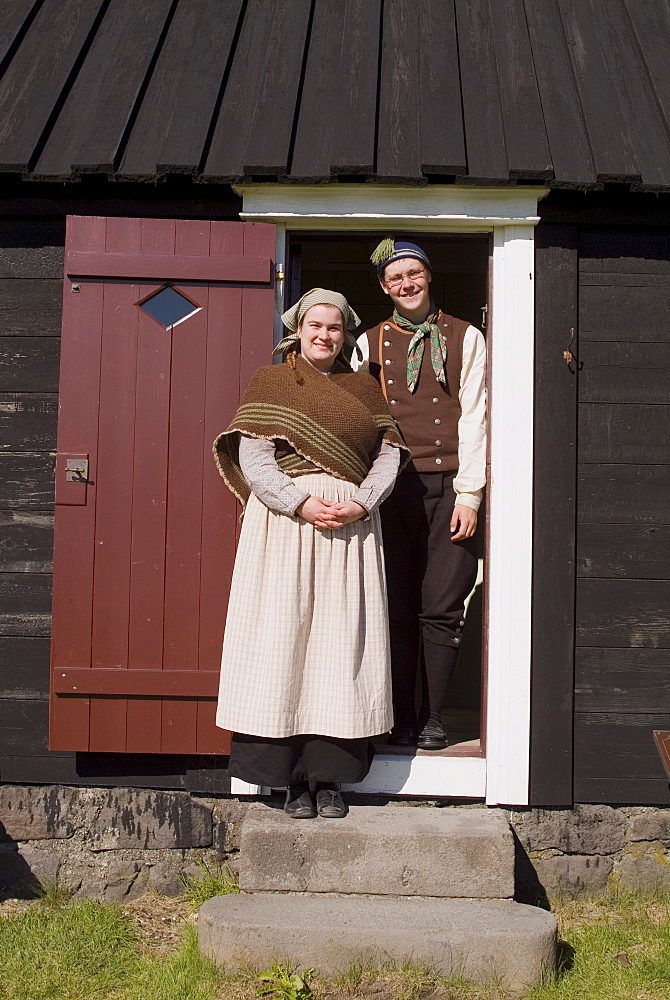 Workers in costume, the Arbaejarsafn Open Air Museum of traditional housing throughout Iceland, Ellidaar Valley, Reykjavik, Iceland, Polar Regions