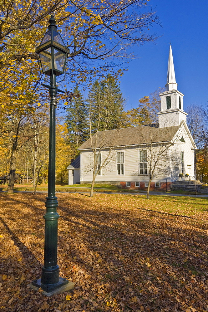 Autumn fall colours around traditional white timber clapperboard church, Grafton, Vermont, New England, United States of America, North America