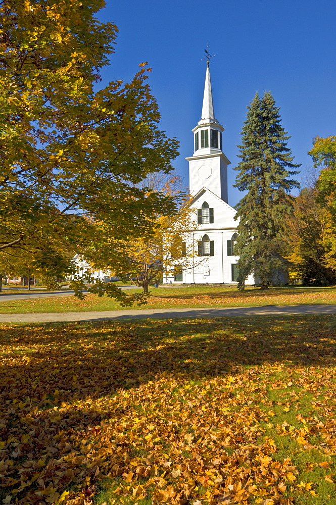 Autumn fall colours around traditional white timber clapperboard church, Townshend, Vermont, New England, United States of America, North America