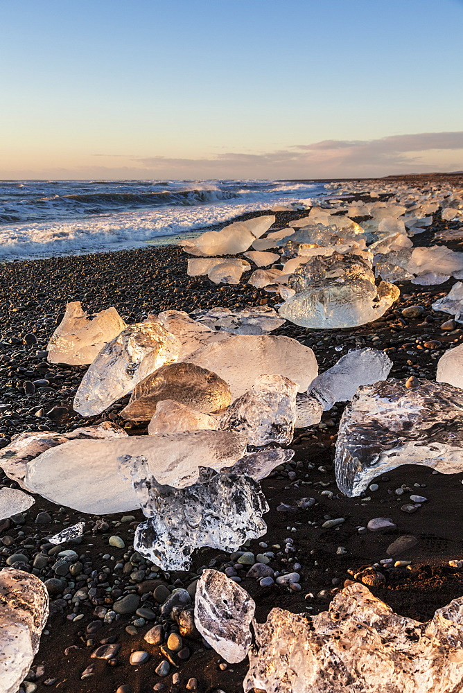 Broken ice from washed upiIcebergs on Jokulsarlon black beach at sunrise, Jokulsarlon, south east Iceland, Iceland, Polar Regions