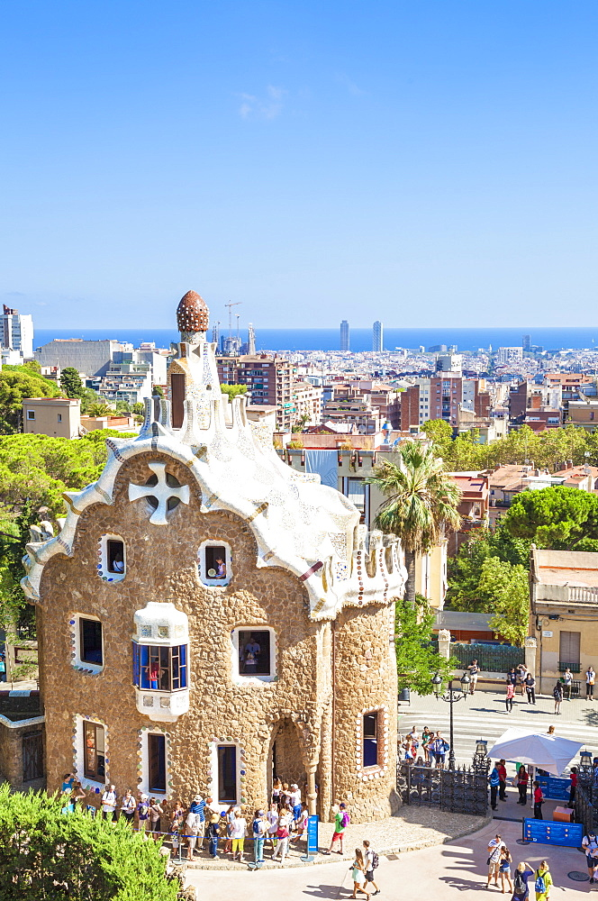 Casa del Guarda lodge by Antoni Gaudi at Parc Guell, UNESCO World Heritage Site, with a skyline view of the city of Barcelona, Catalonia (Catalunya), Spain, Europe