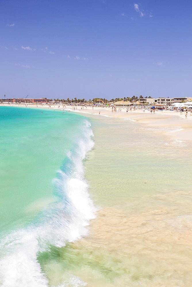 Waves breaking on the sandy beach in Santa Maria, Praia de Santa Maria, Baia de Santa Maria, Sal island, Cape Verde, Africa