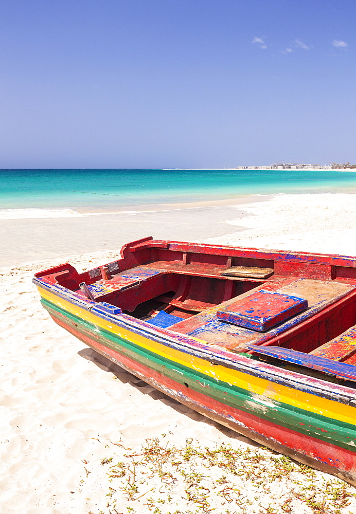 Colourful traditional local fishing boat on the beach at Santa Maria, Praia da Santa Maria, Sal Island, Cape Verde, Atlantic, Africa