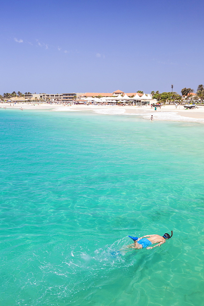 Boy snorkelling off the sandy beach in Santa Maria, Praia de Santa Maria, Baia de Santa Maria, Sal Island, Cape Verde, Atlantic, Africa