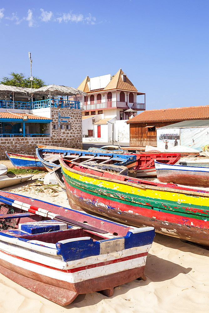 Colourful traditional local fishing boats on the beach at Santa Maria, Praia da Santa Maria, Sal Island, Cape Verde, Atlantic, Africa