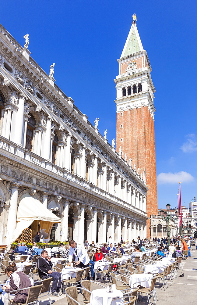 Campanile tower, Piazzetta, and tourists enjoying the cafes of St. Marks Square, Venice, UNESCO World Heritage Site, Veneto, Italy, Europe
