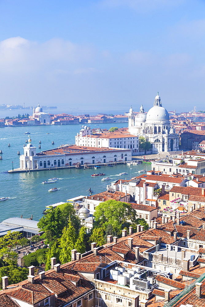 Vaporettos (water taxis), rooftops and the church of Santa Maria della Salute, on the Grand Canal, UNESCO World Heritage Site, Venice, Veneto, Italy, Europe