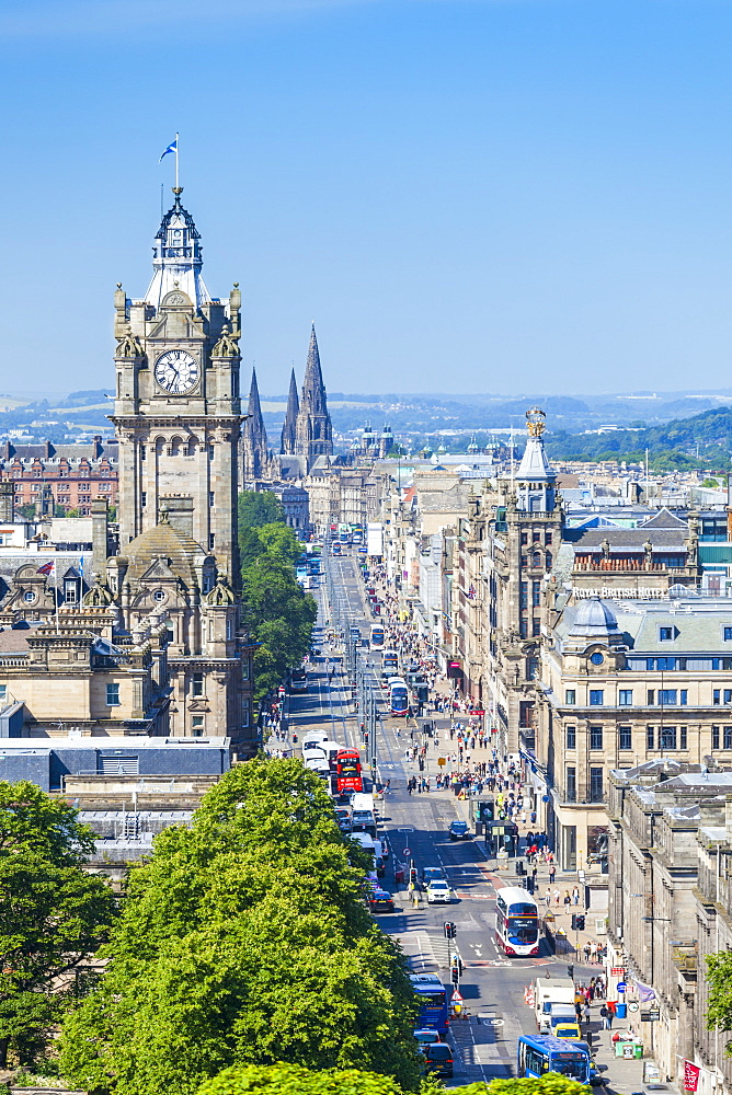 Busy traffic on Princes Street, city centre and Edinburgh skyline, Edinburgh, Midlothian, Scotland, United Kingdom, Europe