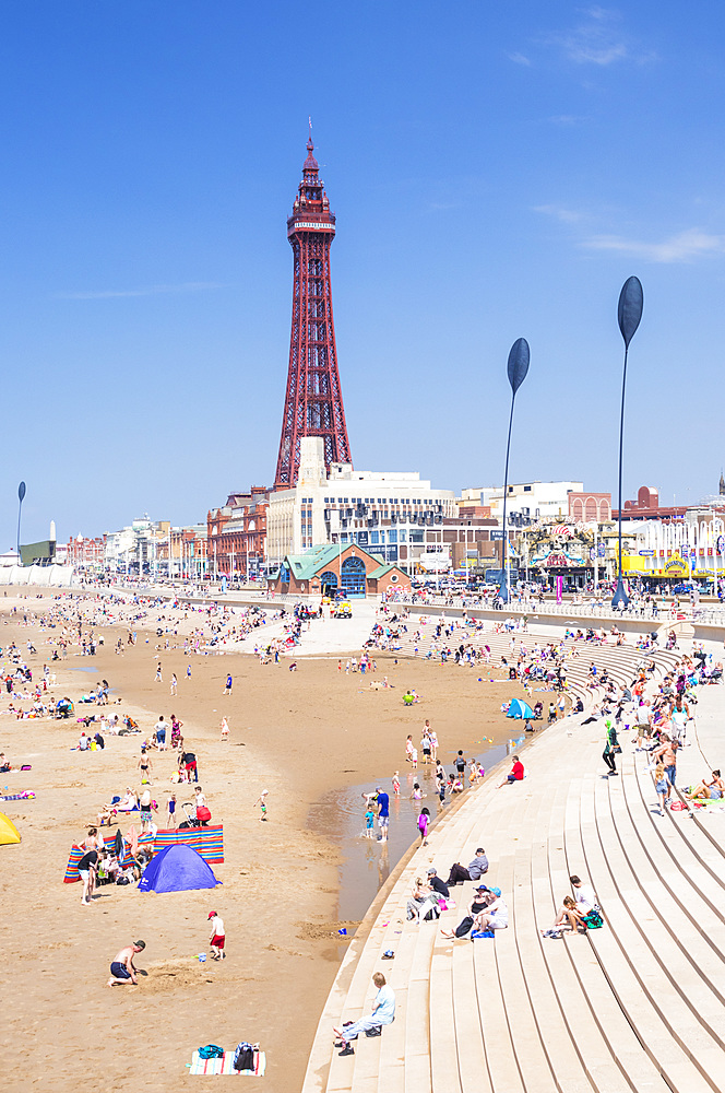 Blackpool Tower, Blackpool beach and seafront promenade with holidaymakers annd tourists, Blackpool, Lancashire, England, United Kingdom, Europe