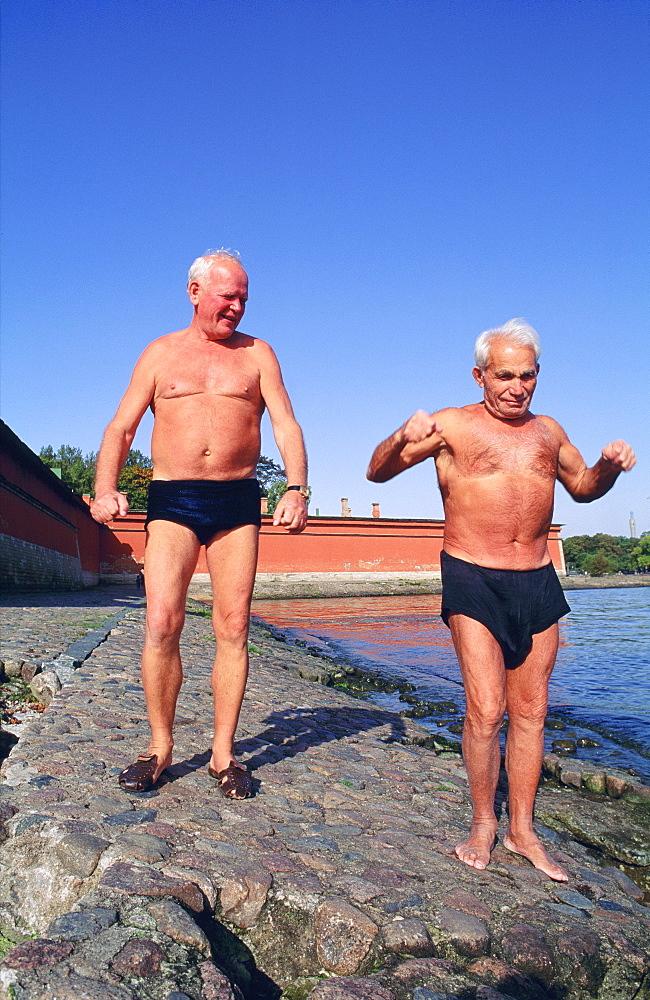 Elderly bathers on the banks of the Neva River, St Petersburg
