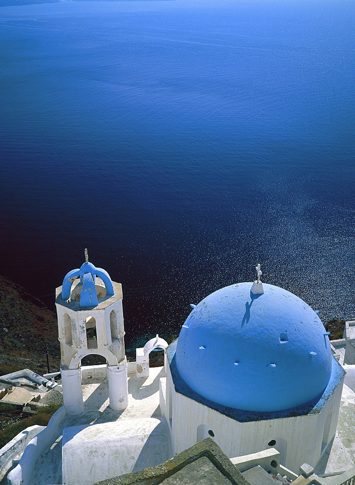 Aerial view over a church perched over sea, Fira Town