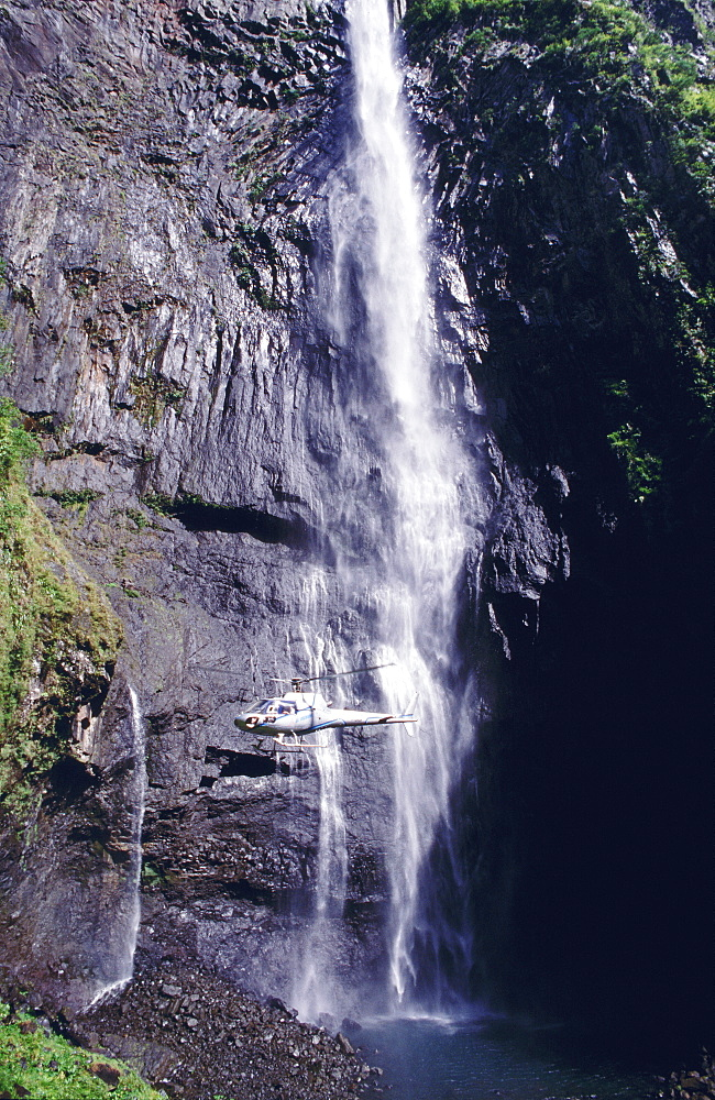 Waterfall and helicopter, Reunion Island, Africa
