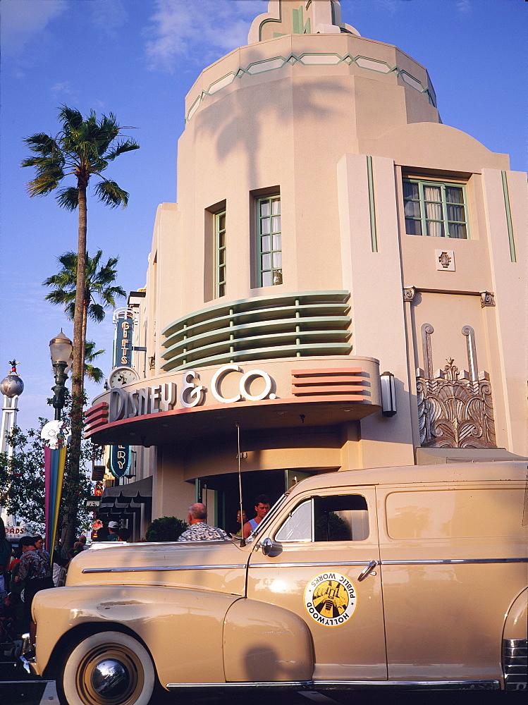 Classic car outside art deco Disney building, Main Street, MGM Park, Orlando, Florida, USA