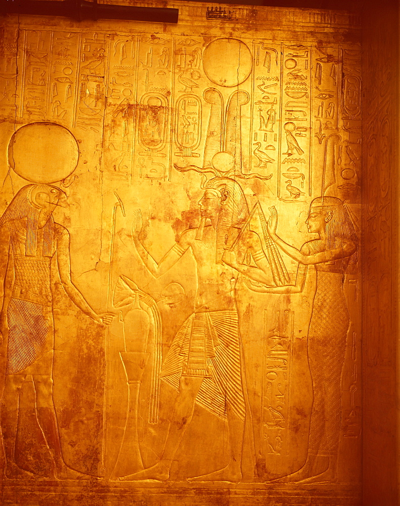 Detail of the king wearing Osiris crown with gods Reherakte and Maat on shrine of Tutankhamun, Cairo Museum, Egypt, North Africa, Africa