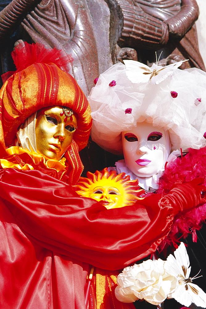 People wearing masked carnival costumes, Venice Carnival, Venice, Veneto, Italy