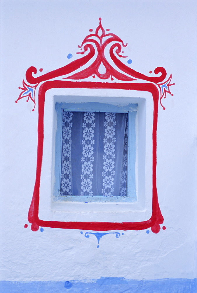 Decorated window in a white wall, Asilah, Atlantic coast, Morocco, Africa - 712-1372