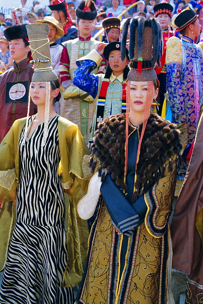 People in traditional costumes at the tournament, Naadam Festival, Ulaan Baatar (Ulan Bator), Mongolia, Asia