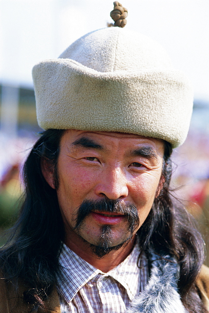 Portrait of a man at the Naadam Festival, Ulaan Baatar (Ulan Bator), Mongolia, Asia