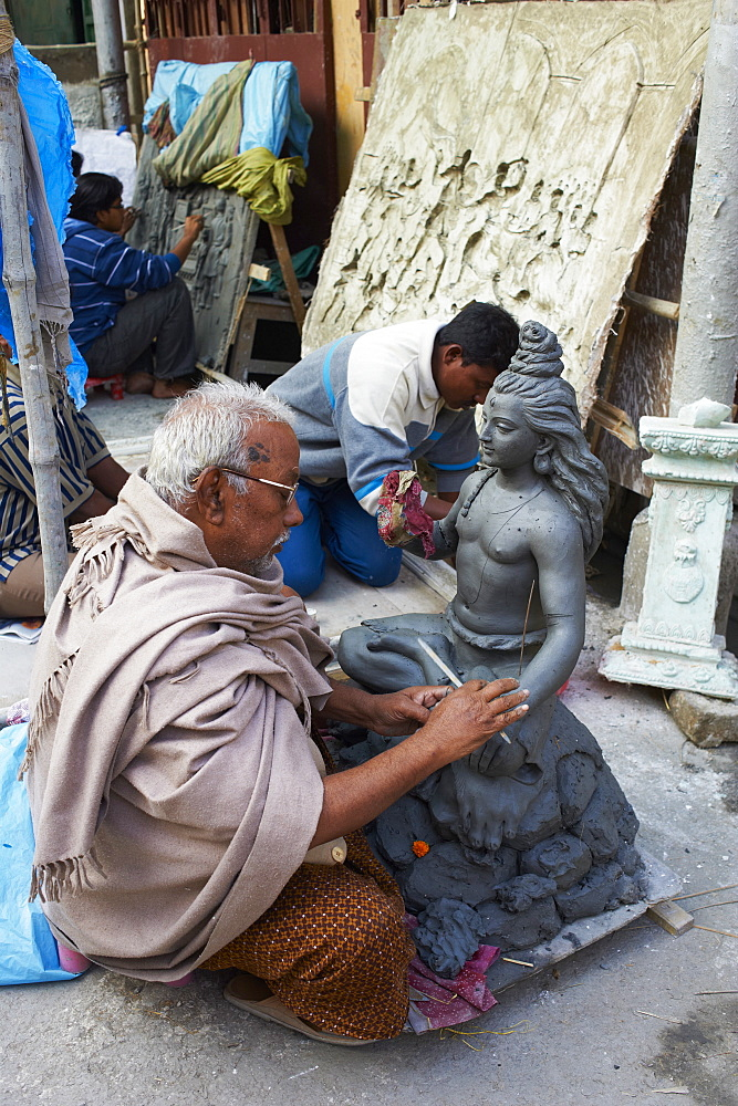 Making clay statues of a Hindu goddess, Kumartulli district, Kolkata (Calcutta), West Bengal, India, Asia
