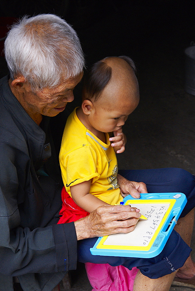 Grandfather and  child, Dong village of Zhaoxing, Guizhou Province, China, Asia - 712-2621