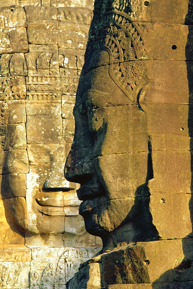 Stone heads typifying Cambodia on the Bayon Temple at Angkor Wat, Siem Reap, Cambodia, Asia. *** Local Caption ***   - 712-916