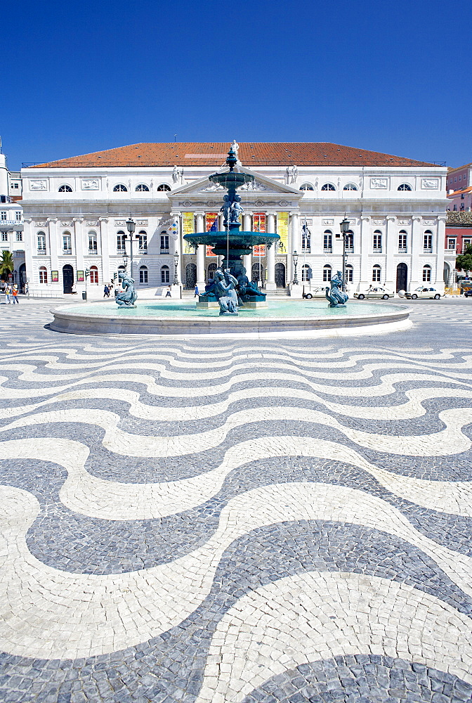 Mosaics and fountain with Lisbon Opera House in the background, Praca Dom Pedro IV (Rossio Square), Lisbon, Portugal, Europe
