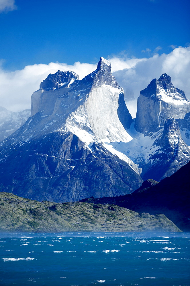 Cuernos del Paine (Horns of Paine) and blue waters of Lake Pehoe, Torres del Paine National Park, Patagonia, Chile, South America