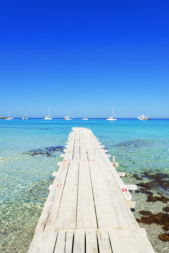 Pier in Formentera's turquoise waters, Formentera, Balearic Islands, Spain, Mediterranean, Europe
