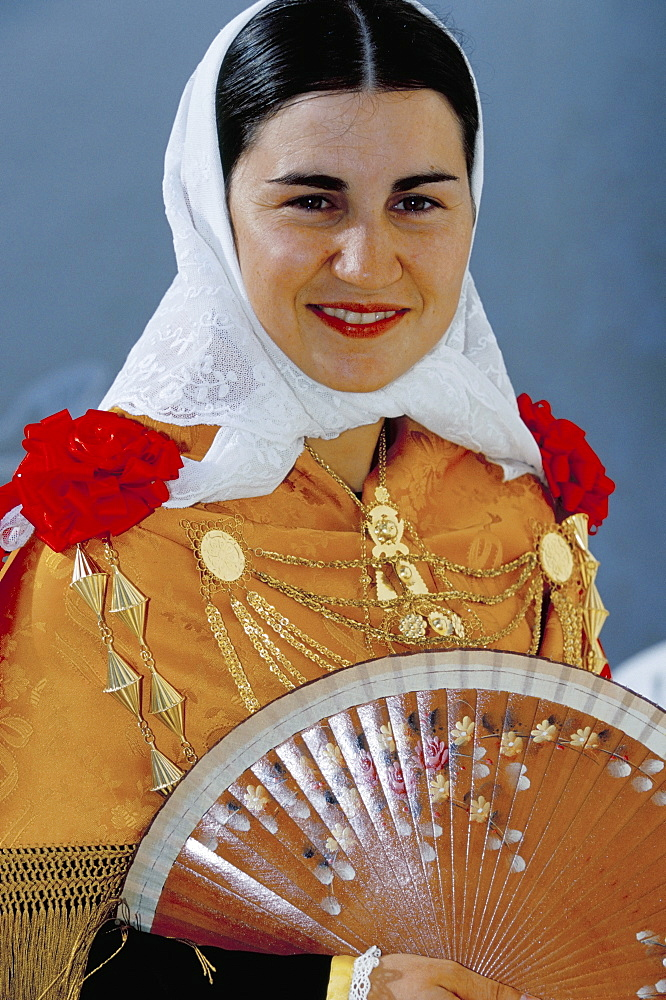 Portrait of a young country woman wearing typical dress and jewellery, Sant Miguel de Balansat, Ibiza, Balearic Islands, Spain, Meidterranean, Europe - 718-56