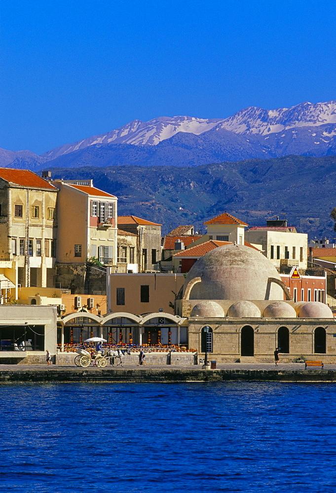 Hania (Chania) seafront and Levka Ori (White Mountains) in the background, Hania, island of Crete, Greece, Mediterranean, Europe
