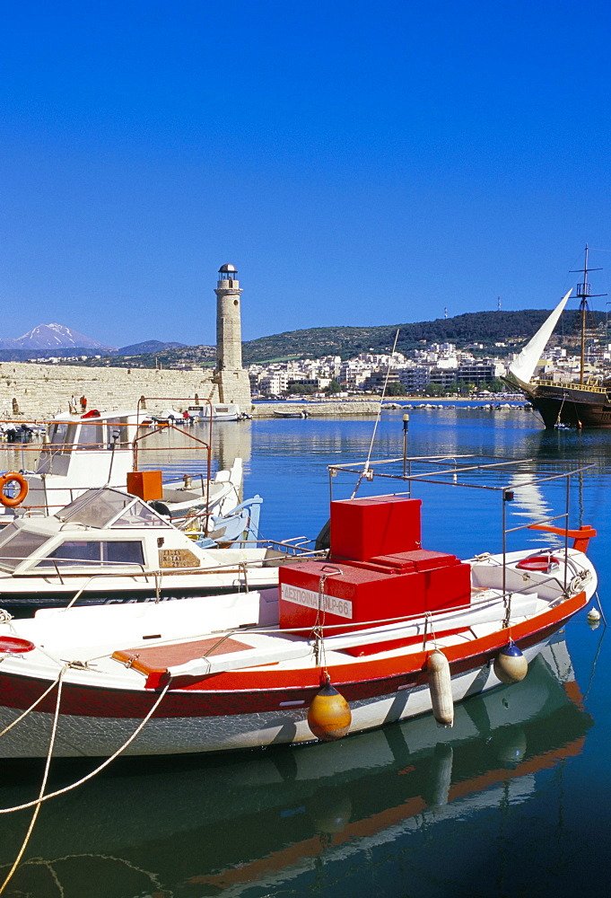 View of old Venetian Rethymo harbour and lighthouse in background, Rethymno (Rethymnon), island of Crete, Greece, Mediterranean, Europe