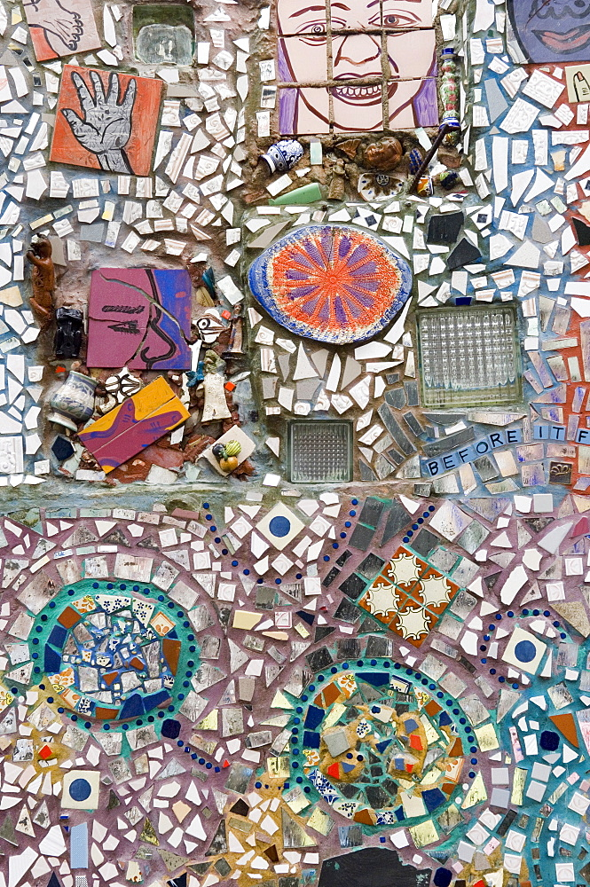 Decoration of patterns in glass, mirrors, ceramics and other fragments of objects embedded in stucco by sculptor Isaiah Zagar, South Street, Philadelphia, Pennsylvania, United States of America, North America