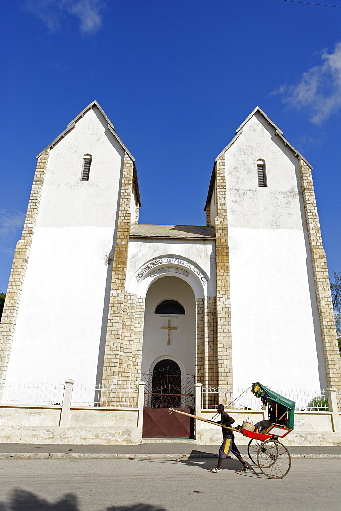 Rickshaw passing Lutheran Church, Toliara (Tulear), capital of the Atsimo-Andrefana region, Madagascar, Africa  - 724-2457