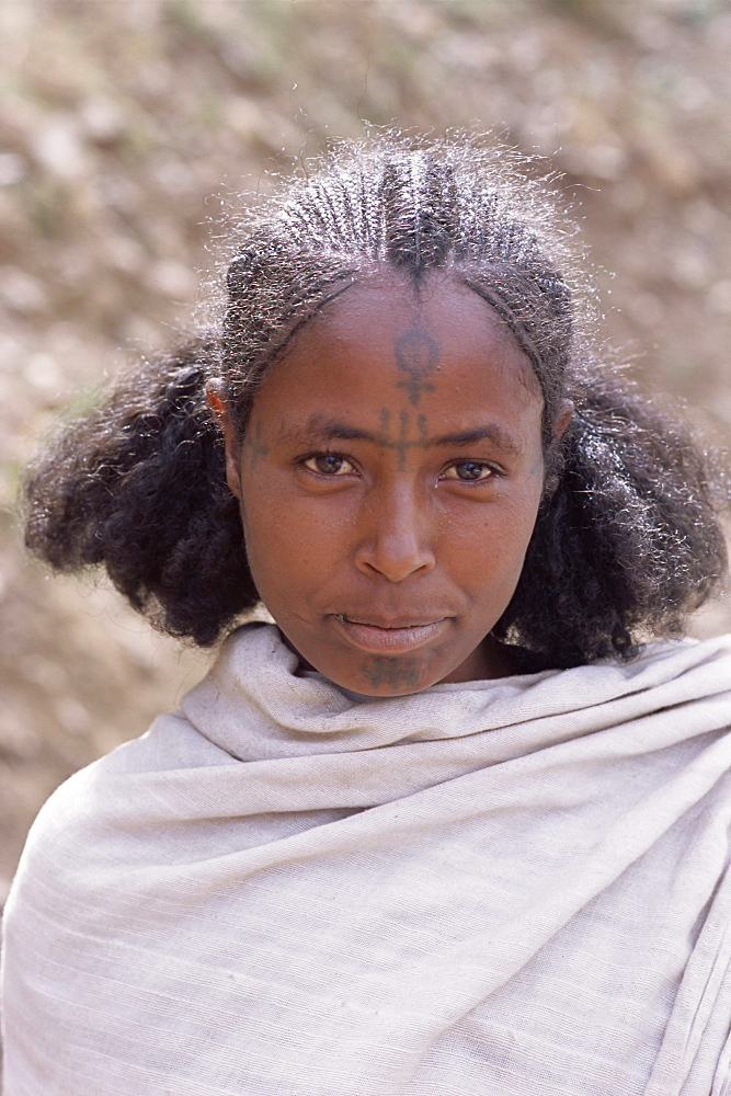 Head and shoulders portrait of a young Gourage woman with facial tattoo, Lasta Valley, Wollo region, Ethiopia, Africa