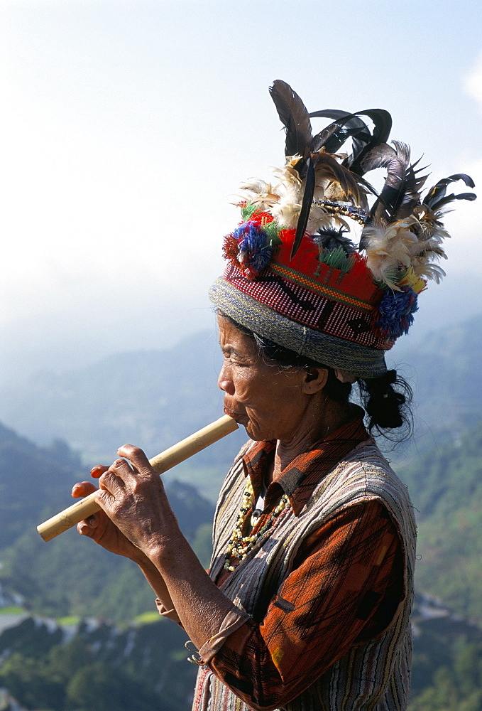 Ifugao person playing a pipe, northern area, island of Luzon, Philippines, Southeast Asia, Asia