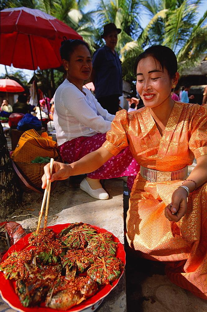 Dai woman cooking at market stall (ethnic minority group) Xishuangbanna, Yunnan, China. 2002