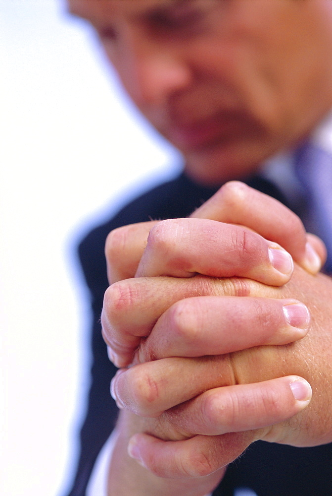 Close-up of business man's clenched hands